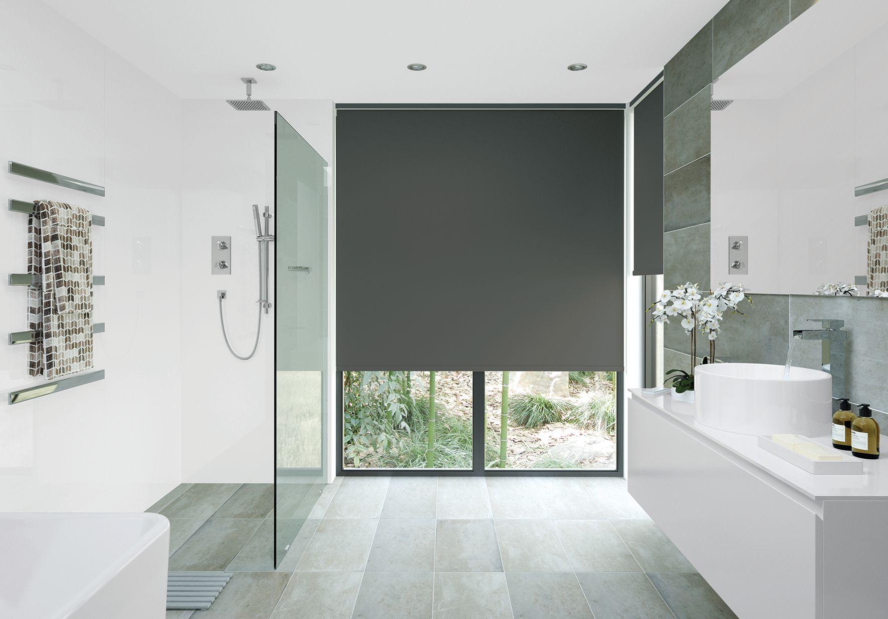 Dark roller blinds to match a dark window frame